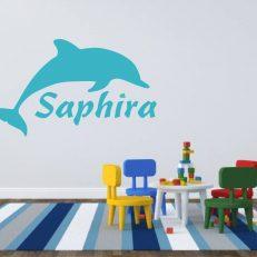 Muursticker met de afbeelding van een dolfijn. Inclusief een eigen naam