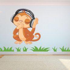 Muursticker Full Color Muziek luisterende aap. Mooie muursticker