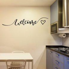 """Muursticker met de tekst """"Welcome"""". In Nederlands: Welkom. Inclusief hart"""