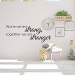"Muursticker met de tekst ""Alone we are strong, Together we are stronger"""