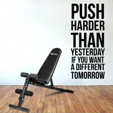 Muursticker. Tekst: Push harder then yesterday if you want another...etc.""