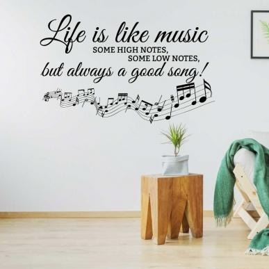 "Muursticker met de tekst ""Life is like music Some high notes...etc""."