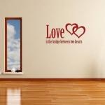 Muursticker Tekst: Love is the bridge between two hearts