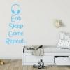 Muursticker Tekst: Eat Sleep Game Repeat.. Met koptelefoon K564A